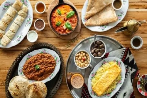 Breakfast with Side and Drink for Two or Four at Al Fanar Restaurant And Cafe (41% Off)